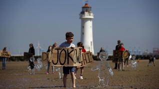FOTO: Perubahan Iklim, Jokowi dan Patung Es di Pantai Inggris