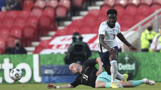 Portsmouth memecat tiga pemain akademi yang mengirim pesan rasial tentang bintang Arsenal Bukayo Saka usai timnas Inggris gagal juara Euro 2020.