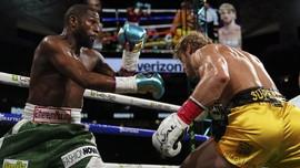 Tyson Kritik Mayweather: Seharusnya Dia Lawan Pacquiao