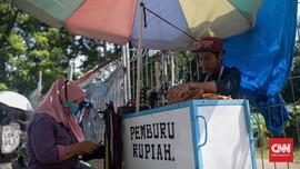 FOTO: Penjahit Keliling Menjemput Rezeki di Jalanan Ibu Kota