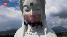 VIDEO: Patung Buddha Raksasa Gunakan Masker