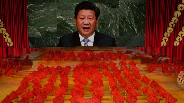 Chinese President Xi Jinping is displayed on a screen as performers dance at a gala show ahead of the 100th anniversary of the founding of the Chinese Communist Party in Beijing on Monday, June 28, 2021. China is marking the centenary of its ruling Communist Party this week by heralding what it says is its growing influence abroad, along with success in battling corruption at home. Party officials on Monday heaped praise on President Xi Jinping, who has established himself as China's most powerful leader since Mao Zedong, and has eliminated any limits on his term in office. (AP Photo/Ng Han Guan)