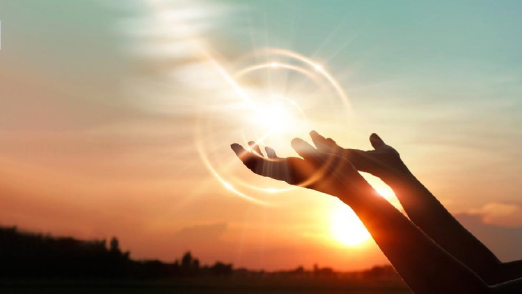 Woman hands praying for blessing from god on sunset background