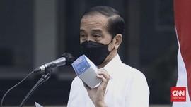 Blusukan ke Jakut, Jokowi Disebut Titipkan Obat Covid ke RT