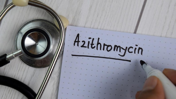Azithromycin text write on a book isolated on office desk. Healthcare/Medical concept