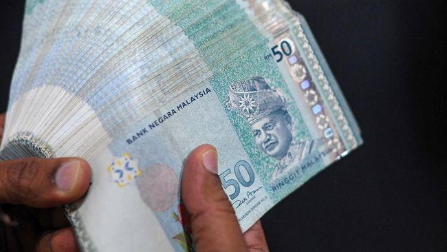 BI dan Bank Negara Malaysia memperkuat kerja sama pembayaran transaksi investasi langsung dan sepakat melonggarkan aturan transaksi valas dua negara.