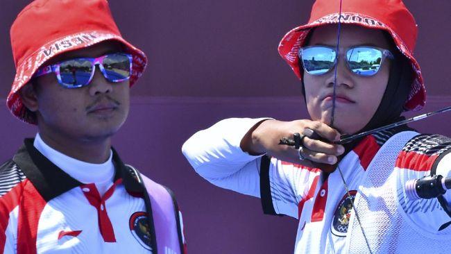 Ganda panahan Indonesia, Riau Ega Aghata dan Diananda Chaoirunisa, tampil impresif di babak 16 besar beregu campuran Olimpiade Tokyo 2020.