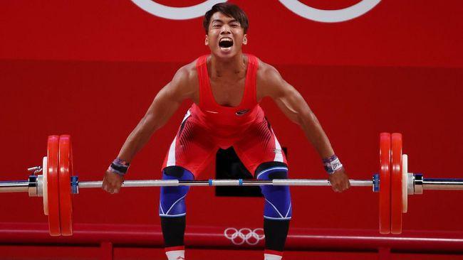 Lifter Indonesia Deni gagal menyumbang medali dari cabang angkat besi 67kg putra di Olimpiade Tokyo 2020, Minggu (22/7).