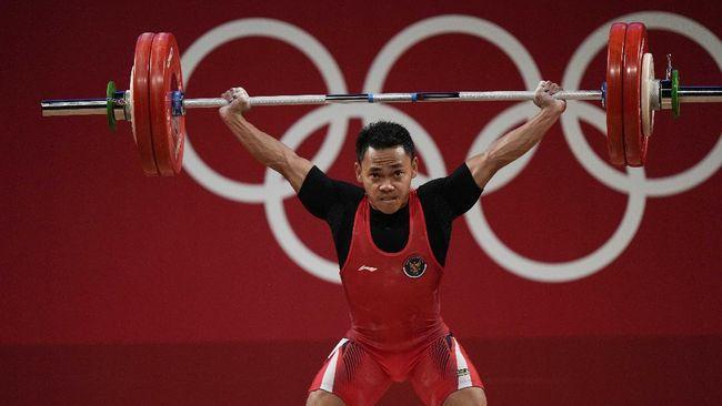 Eko Yuli Irawan berhasil mempersembahkan medali perak dari cabang angkat besi kelas 61 kilogram putra Olimpiade Tokyo 2020, Minggu (25/7).