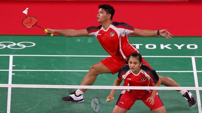 Praveen Jordan/Melati Daeva Oktavianti berhasil mengalahkan Mathias Christiansen/Alexandra Boje dengan 24-22, 21-19 di badminton Olimpiade Tokyo 2020.