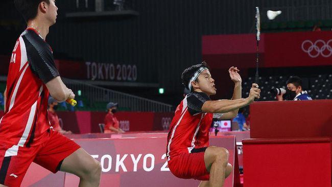 Kevin Sanjaya/Marcus Gideon dipastikan tetap menjadi juara Grup A Olimpiade Tokyo 2020 meski kalah dari Lee Yang/Wang Chi-Lin pada laga terakhir.