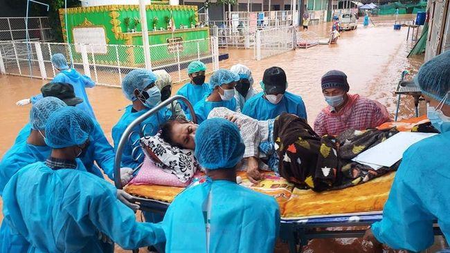 Ratusan orang mengungsi akibat banjir di tengah lonjakan kasus Covid-19 di Myanmar, negara yang juga tengah didera krisis politik akibat kudeta itu.