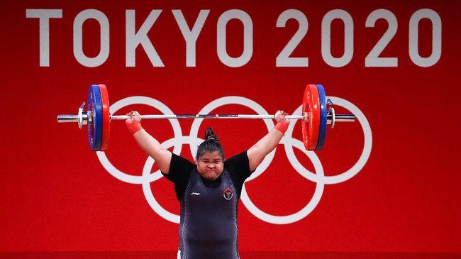 Nurul Akmal menjadi salah satu atlet angkat besi Indonesia yang berangkat ke Olimpiade Tokyo 2020 dan menorehkan sejarah untuk Aceh.