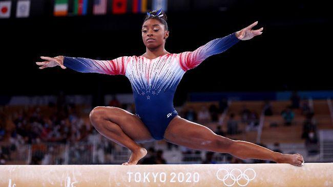 Pesenam artistik Simone Biles kembali bertanding di Olimpiade Tokyo 2020. Dia kembali dengan kilauan di medali perunggu dan leotard bertabur kristal.