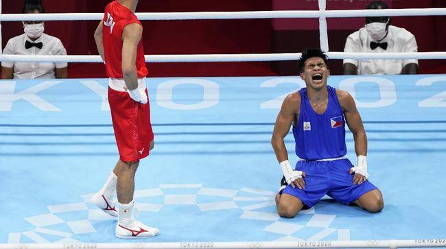 Filipina dipastikan bakal menggeser peringkat Indonesia di Olimpiade Tokyo seiring keberhasilan Carlo Paalam lolos ke final tinju kelas terbang.