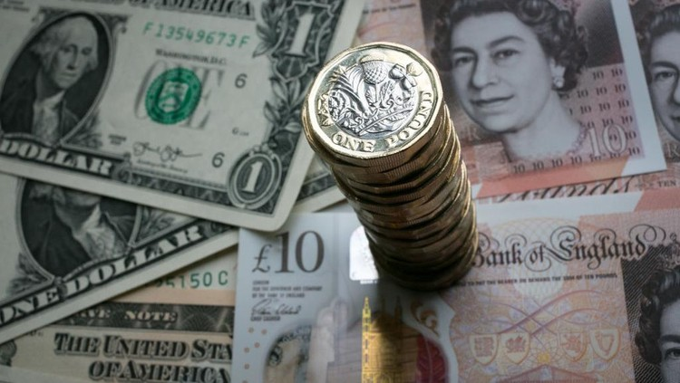BATH, ENGLAND - OCTOBER 13:  In this photo illustration, a stack of £1 coins is seen with the new £10 note alongside US dollar bills on October 13, 2017 in Bath, England. Currency experts have warned that as the uncertainty surrounding Brexit continues, the value of the British pound, which has remained depressed against the US dollar and the euro since the UK voted to leave in the EU referendum, is likely to fluctuate.  (Photo Illustration by Matt Cardy/Getty Images)