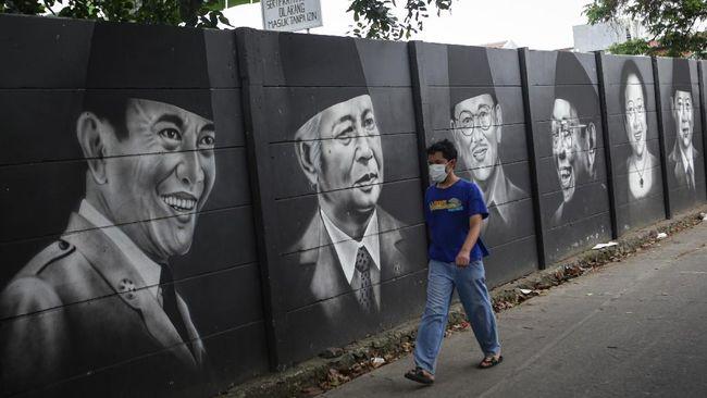 Mural itu memperlihatkan gambar wajah yang mirip dengan Jokowi namun pada bagian matanya ditutupi dengan tulisan 404:Not Found.