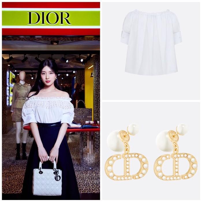 Suzy menggunakan atasan Off-Shoulder Blouse berwarna putih seharga 1550 USD dan aksesoris Dior Tribales Earrings seharga 720 USD. Atasan dan anting ini merupakan koleksi terbaru Autumn-Winter 2021 karya Maria Grazia Chiuri./ Foto: Instagram.com/skuukzky