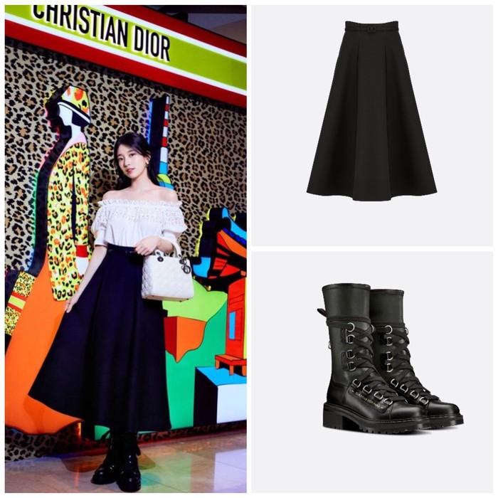 Untuk bawahannya, Suzy menggunakan Mid-Length Skirt berwarna hitam seharga 4500 USD. Senada dengan warna rok, Suzy menggunakan D-Fight Ankle Boot yang dibanderol dengan harga 1890 USD. Perpaduan gaya ini membuat Suzy terlihat chic!/ Foto: Instagram.com/skuukzky
