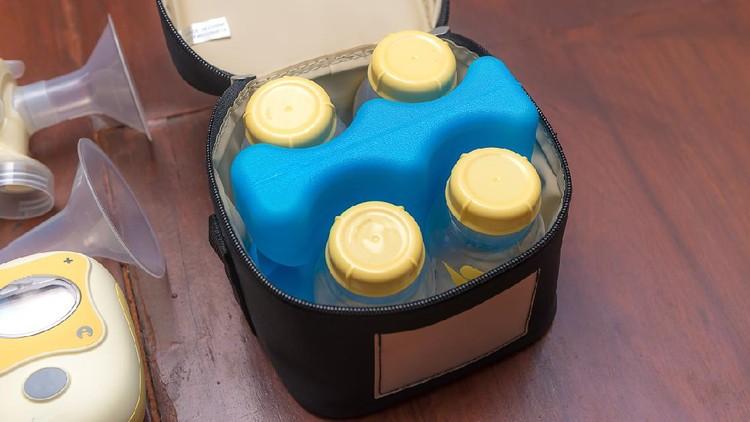 Set of  Baby milk bottles in cooling bag