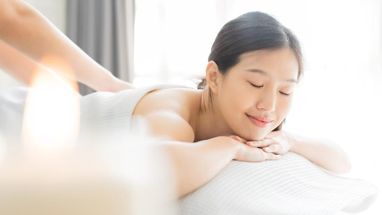 Young Asian woman  in spa salon getting massage.