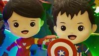 <p>Dekorasinya bertema Marvel. Terdapat dua figur anak laki-laki yang memakai kostum Iron Man dan Captain America. Bisa ditebak Raphael dan Mikhael masing-masing pakai kostum apa?(Foto: Instagram @sandradewi88)</p>