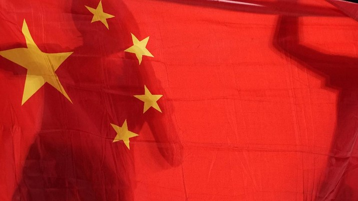 China's Chen Meng, left, and Sun Yingsha hold their national flag after winning the table tennis women's singles gold medal match at the 2020 Summer Olympics, Thursday, July 29, 2021, in Tokyo. (AP Photo/Kin Cheung)