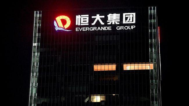 Pengembang raksasa China yang sedang terbelit masalah keuangan, China Evergrande Group mulai membayar utang pada investor mereka dengan properti.