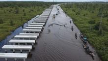 FOTO: Jalan Trans Kalimantan Bukit Rawi Terendam Banjir