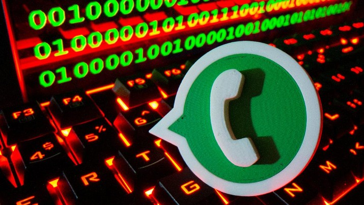 A 3D printed Whatsapp logo is pictured on a keyboard in front of binary code in this illustration taken September 24, 2021. REUTERS/Dado Ruvic/Illustration