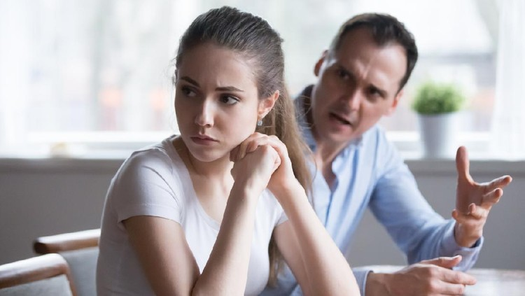 Offended woman sitting back to lover looking away avoiding talking, millennial couple having serious fight, mad man screaming or lecturing wife, stubborn female not ready to compromise or reconcile