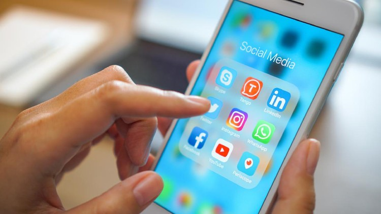 Bangkok, Thailand - JUN 18, 2018: social medial app iPhone mobile phone with blue screen background technology business smartphone digital communication facebook and internet editorial