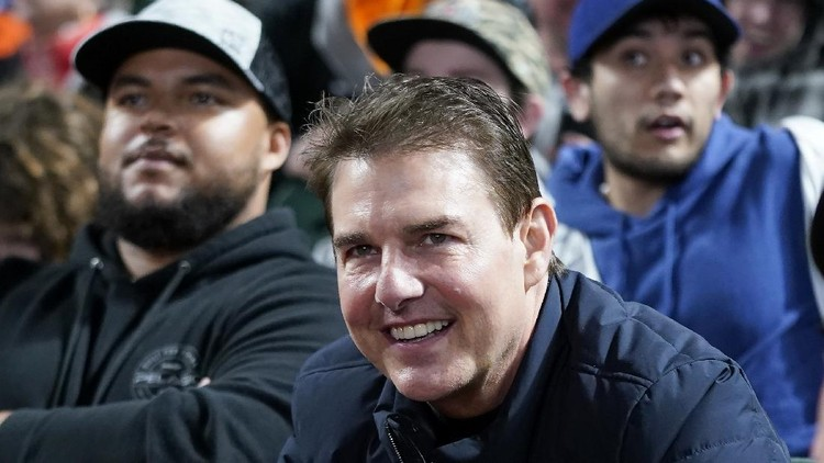 Actor Tom Cruise smiles during Game 2 of a baseball National League Division Series between the San Francisco Giants and the Los Angeles Dodgers Saturday, Oct. 9, 2021, in San Francisco. (AP Photo/Jeff Chiu)